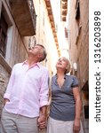mature tourist couple walking... | Shutterstock . vector #1316203898