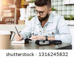 young bearded hipster man sits... | Shutterstock . vector #1316245832
