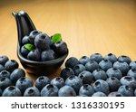 pile of blueberries in black... | Shutterstock . vector #1316330195