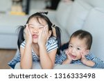 cute asian children lying on... | Shutterstock . vector #1316333498