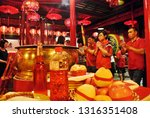 the people were praying at the ... | Shutterstock . vector #1316351408