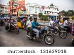 Small photo of THANJAVUR, INDIA - FEBRUARY 13: Indian riders ride motorbikes on busy road on February 13, 2010 in Thanjavur, India. Motorbike is the most favorite vehicle and most affordable for India.