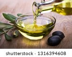 bowl with olive oil on wooden... | Shutterstock . vector #1316394608