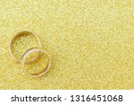 gold wedding rings of bride and ... | Shutterstock . vector #1316451068
