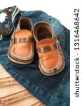 old baby shoes. moccasins | Shutterstock . vector #1316468642