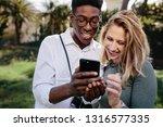 smiling multiracial couple... | Shutterstock . vector #1316577335