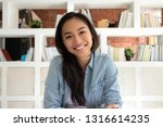 smiling asian young woman... | Shutterstock . vector #1316614235