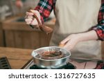 fondue with melting chocolate... | Shutterstock . vector #1316727635