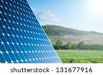 Solar Panel With Green Landscape Against The Blue Sky With Sunshine - stock photo