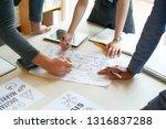hands of coworkers bending over ... | Shutterstock . vector #1316837288