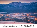 winter panorama of zakopane.... | Shutterstock . vector #1316844812