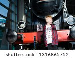 smiling boy stands in front of...   Shutterstock . vector #1316865752