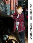 smiling boy standing next to...   Shutterstock . vector #1316865755