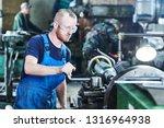 worker turner operating lathe... | Shutterstock . vector #1316964938