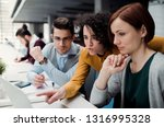 group of young businesspeople... | Shutterstock . vector #1316995328