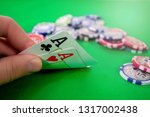 aces in poker hand chips | Shutterstock . vector #1317002438