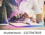 hands typing on laptop....   Shutterstock . vector #1317067835