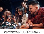 at the bar table. beautiful... | Shutterstock . vector #1317115622