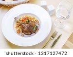duck confit leg with white bean ... | Shutterstock . vector #1317127472