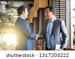 two mature businessmen in suits ... | Shutterstock . vector #1317203222