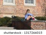 an attractive blonde college... | Shutterstock . vector #1317266015