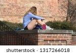 an attractive blonde college... | Shutterstock . vector #1317266018