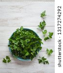 parsley leaves flat lay. fresh... | Shutterstock . vector #1317274292