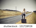 Young Woman Playing Guitar On...