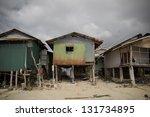 Small photo of Poor fishers houses along sea coast, Koh Samui, Thailand