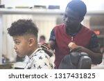 boy in the african barbershop.... | Shutterstock . vector #1317431825