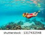 young happy girl in snorkeling...   Shutterstock . vector #1317432548