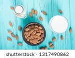 almond milk on wooden table ....   Shutterstock . vector #1317490862