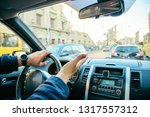 man driving car in city traffic....   Shutterstock . vector #1317557312