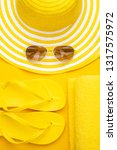 beach accessories on the yellow ...   Shutterstock . vector #1317575972