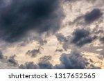 ragged storm clouds cross an... | Shutterstock . vector #1317652565