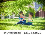 happy summer holidays. two... | Shutterstock . vector #1317653522
