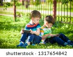 two brother kid is lying on the ... | Shutterstock . vector #1317654842