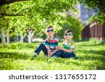 happy summer holidays. two... | Shutterstock . vector #1317655172