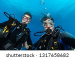 young woman and man scuba... | Shutterstock . vector #1317658682