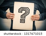hand with paper with... | Shutterstock . vector #1317671015