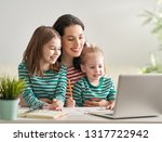 young mother with children... | Shutterstock . vector #1317722942