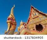 naga and golden buddha image at ... | Shutterstock . vector #1317834905