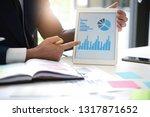 close up business man hand... | Shutterstock . vector #1317871652