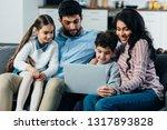 happy hispanic family looking... | Shutterstock . vector #1317893828