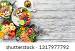 buddha bowl on a white wooden... | Shutterstock . vector #1317977792