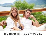 sexy couple relaxing outdoors... | Shutterstock . vector #1317993362