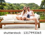 relaxing couple on sofa on... | Shutterstock . vector #1317993365