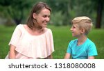 happy mum and son looking at... | Shutterstock . vector #1318080008