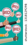 hands holding auction paddle.... | Shutterstock . vector #1318129298