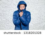 sad asian man in blue down... | Shutterstock . vector #1318201328